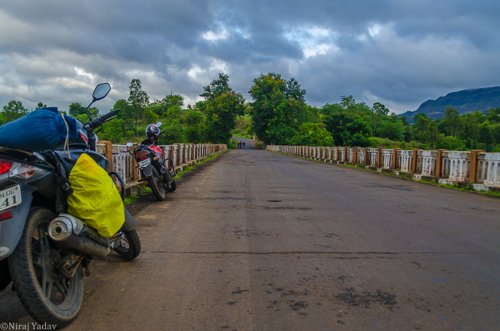 Motorcycle touring India photo on river bridge