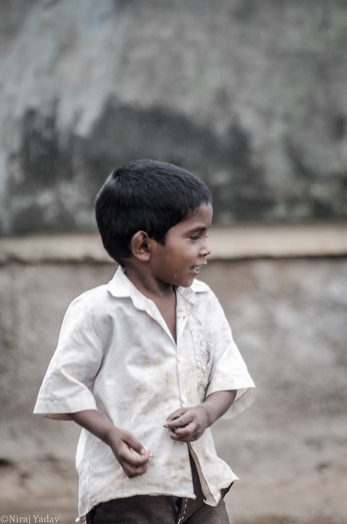 A young boy in indian tribal village getting ready for school
